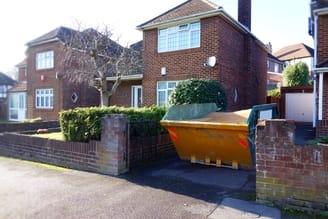 Large skip in narrow driveway